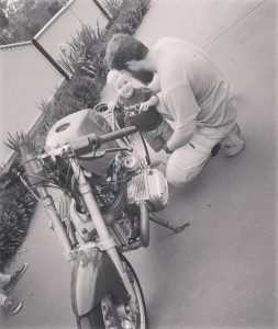 Son and Dad fixing motorbike