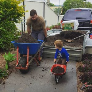 Son and Dad working in the yard